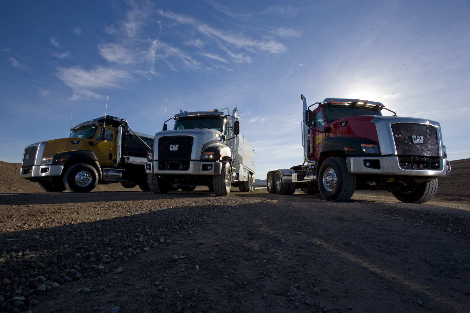 3 On-Highway Caterpillar Trucks