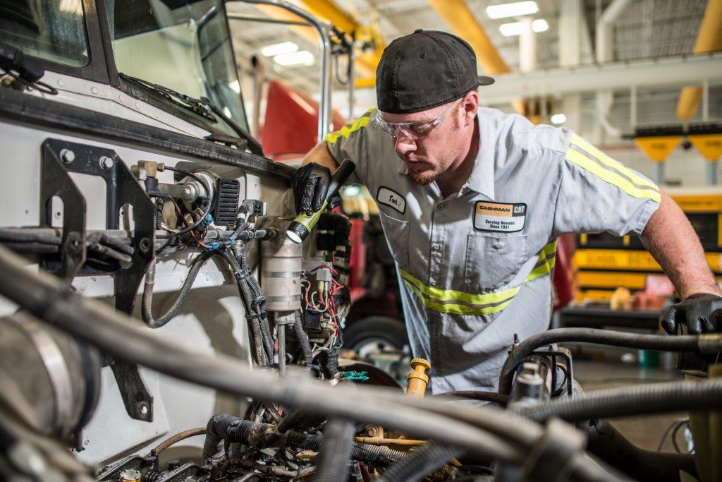 Caterpillar Truck Service Technician working on Truck Engine